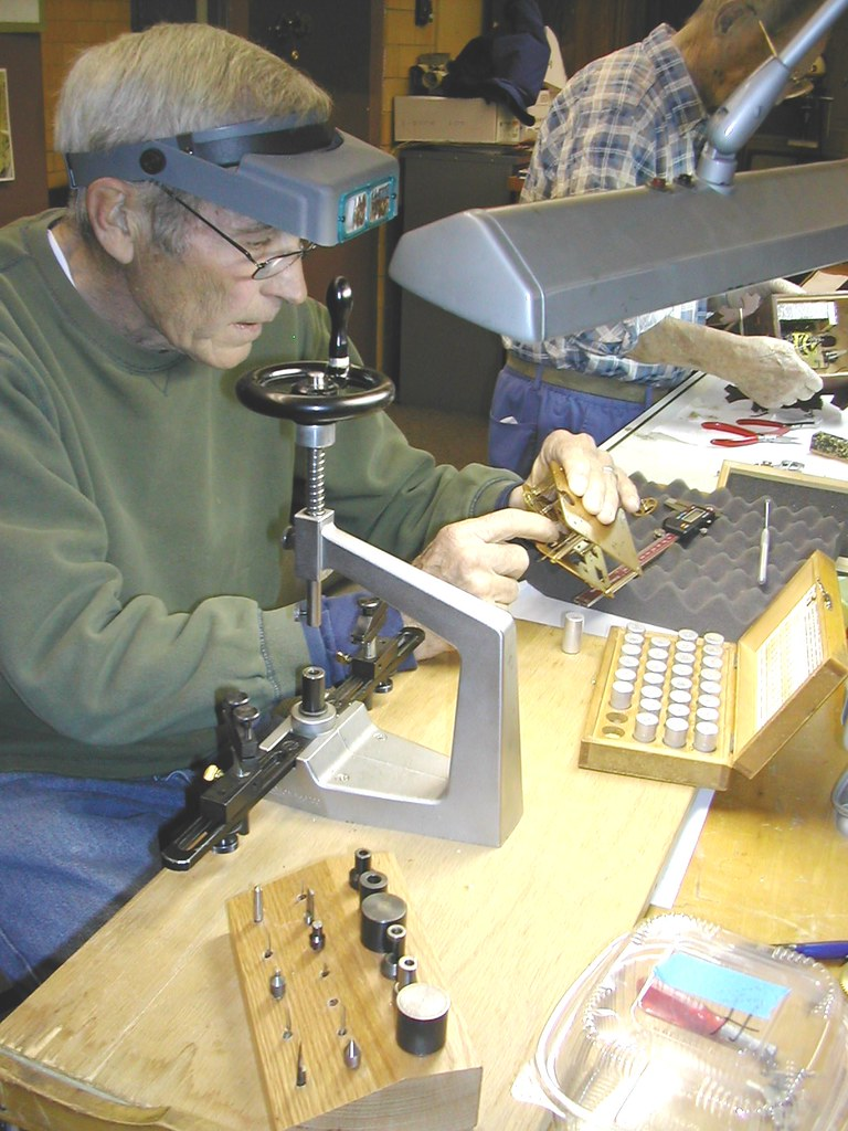 Clock Repair: Brad re-bushing a clock