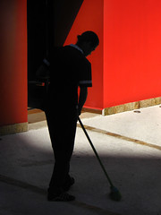 Sweeping in the morning (Carlos Ebert) Tags: city red urban silhouette contrast chapeau paulo maid são sweep janitor sweeping blueribbonwinner golddragon mywinners abigfave aplusphoto theunforgettablepicture colourartaward betterthangood