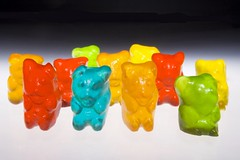 Gummy bears (Luis Eduardo ) Tags: bear blue light red macro verde green luz colors yellow azul backlight canon contraluz rojo candy dancing sweet colorfull bears flash chewy amarillo jelly translucent sugary gummy bailando strobe iluminacion translucid colorido caramelo osos gomita translucido luismosquera