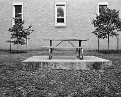 picnic (xgray) Tags: trees windows 2 two blackandwhite bw 3 film wall analog upload 35mm canon austin bench table outside eos prime three blackwhite university texas kodak platform universityoftexas 400 kodakbw400cn picnictable ef35mmf2 400cn bw400cn kodakprofessionalbw400cn 1n jestercenter postedtobwphotographyonlj