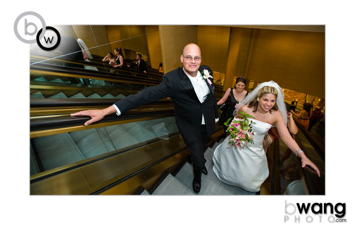 Amy + Dave ride the escalator in Caesar's Palace to their wedding reception