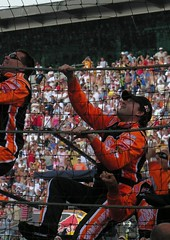 Tony Stewart climbing the fence (LizzieMorrison) Tags: travel orange fence nikon indianapolis smoke lizzie cli