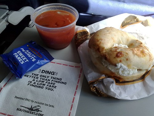 A Jalapeno Cheese Bagel from the Great American Bagel Bakery with a glass of Bloody Mary Mix