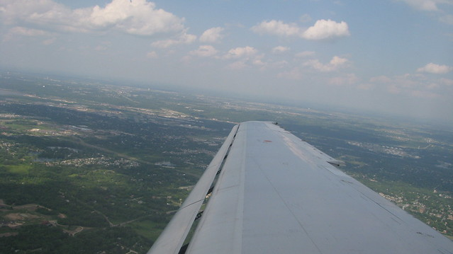 Photograph of the horizon taken from a wing seat of an airplane.