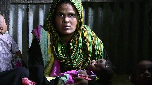 Mother Cradles Her Child
