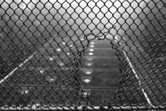 Escape (edouardv66) Tags: bw mist fog 35mm fence switzerland blackwhite nikon suisse hole geneva nb warehouse nikkor genève noirblanc clandestine jonction wirenetting d700 crowdbarrier