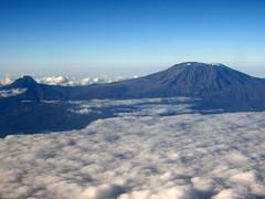 Mount Kilimanjaro from above at dawn (mattk1979) Tags: africa blue sky mountain kilimanjaro clouds airplane tanzania dawn kenya aerial mount uhuru hansmeyerpeak