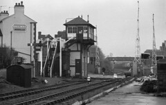 Coalville Leicestershire 13th March 1979 (loose_grip_99) Tags: railroad england station blackwhite crossing noiretblanc leicestershire railway streetscene signals 1979 midland semaphore signalbox coalville eastmidlands lmr britishrailways leicesterswannington