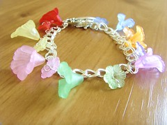 Rainbow Flower Charm Bracelet (Betty1553) Tags: pink orange green bird yellow vintage silver antique turquoise cream jewellery mauve pearl amethyst gemstones swarovskicrystal citrine labradorite semiprecious folksy rosequartz redcoral lapislazuli rainbowrocks luciteflowers