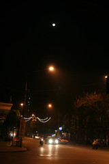Hanoi street by night with moon
