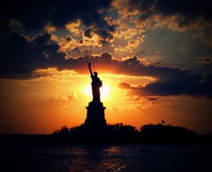 Shadow of Liberty (Neelofar_USA) Tags: pakistan sunset sky usa newyork colors clouds liberty island freedom manhattan muslim pakistani statueofliberty constitution soe satueofliberty ellisisland themoulinrouge firstquality mywinners visiongroup thegardenofzen theroadtoheaven thegoldendreams goldstaraward vision100
