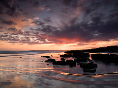 Rocks at low tide (Chris Hammerton) Tags: uk sunset beach southwales landscape coast olympus lowtide ogmore bristolchannel e330 visiongroup vosplusbellesphotos