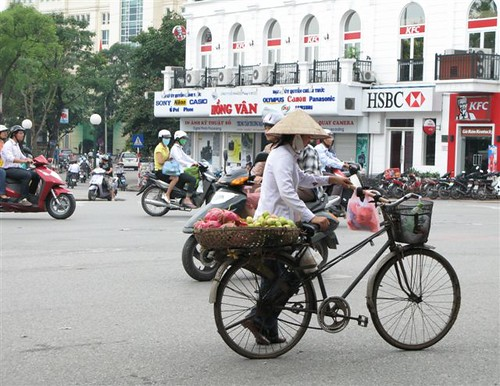 vendor on bicycle