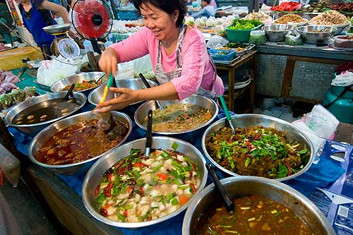 Serving up northern-style curries at  Lampang's evening market