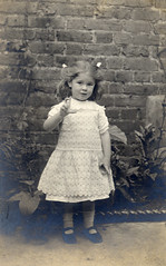 Girl with hair ribbons in the garden (lovedaylemon) Tags: girl wall vintage garden found child image stones edging hairribbon saltglazed
