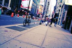 (morgan.laforge) Tags: street newyorkcity blue people bike buildings photography citylife streetcones