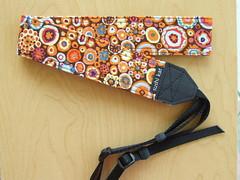 camera strap :: kaffe fassett's pumpkin paperweight