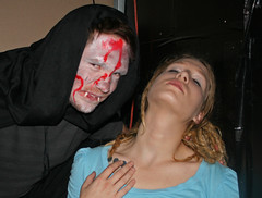Fate and Surrender (PhotoAmateur1) Tags: lighting blue friends party portrait people woman white black hot sexy art fall classic halloween beautiful beauty face fashion closeup shirt female contrast standing canon mouth wonderful pose dark hair neck fun nose photo nice fantastic model eyes colorful soft long pretty close photoshoot emotion bright skin sweet head vampire background gorgeous great profile creative picture dramatic dracula crop ear blonde horror features shoulders collar shining chin magnificent hauntedhouse glamorous darkened