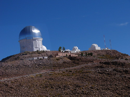 The towers for the four meter and one and a half meter telescopes, along with other smaller ones, are at the highest point in the neighborhood.