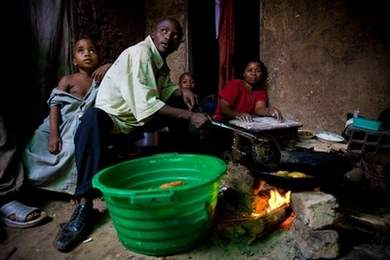 a young ugandan family cooks a meal