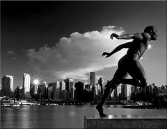 Harry's Jetstream (Christopher J. Morley) Tags: bw cloud statue vancouver buildings blackwhite downtown olympus seawall jetstream cape sunburst stanleypark e3 sprinter alw harryjerome achromatic 100commentgroup