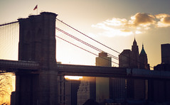 Light Under the Bridge (Fringe Focus) Tags: nyc bridge light sunset sky newyork skyline brooklyn traffic manhattan flag brooklynbridge beams magichour