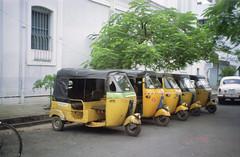 auto stand at pondi (Jennifer Kumar) Tags: negativescan tamilnadu pondicherry autorickshaws india1998 autostand puducherry