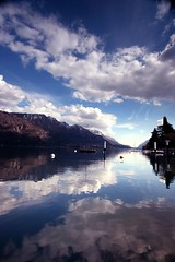 the tranquil side of bellagio (paddimir) Tags: italy mountains alps reflection water clouds boats italian italia peaceful alpine bellagio lakecomo lombardia tranquil lagodicomo lombardy como2008