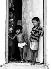 B/W (GraveBone) Tags: ocean poverty door boy people bw white house black girl children grey islands three natural employment indian small poor young social foreign population maldives economy development global mv atoll develop mle dhivehi digg villingili vilimale uniquemaldives gravebone