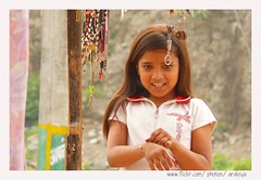 Little Angel in the Market (Araleya) Tags: leica trip travel nepal people girl smile kid asia child market cutie panasonic memory nepalese roadside lovely pokhara nepali southasia fz50 araleya strretshot saarc leicadigital prativichowk