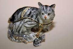 Cat figurine with tiny cat necklace