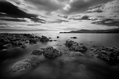 CONVERGING TONES (Edwin_Martinez) Tags: ocean sunset sea landscape coast rocks philippines filipino batangas pinoy pinas nasugbu canon1022mm canon30d hcpphotogs singhrayreversegrad