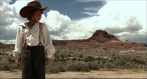 Darrell (Actor Jake Johnson) stares in into vast and lonely landscape of the American West.