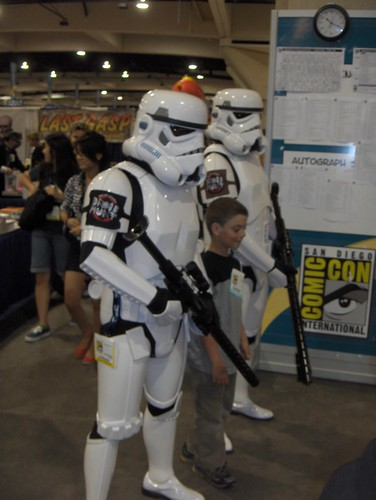 Stormtroopers cart away a young rebel criminal