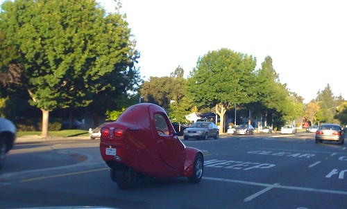 Tiny red car by photomato.