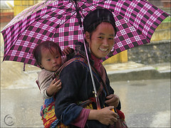 Its raining for 6 days now (NaPix -- (Time out)) Tags: portrait woman baby black rain 6ws sixwordstory mother vietnam motherhood emotions sapa hmong firstquality theworldtroughmyeyes visiongroup napix vision100