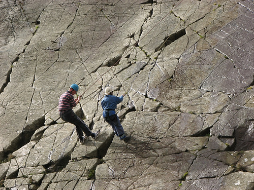 Abseiling down the Barmouth Slabs