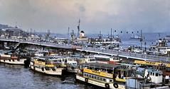 gm_03202 Golden Horn Floating Bridge, Istanbul, Turkey 1975 (CanadaGood) Tags: turkey istanbul sea analog bosphorus galata bridge boat ferry goldenhorn 1975 slidefilm kodachrome turkish slidecube yellow colour color canadagood europe shore