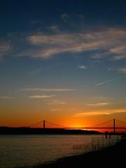 (t3mujin) Tags: bridge blue sunset sky orange portugal water clouds river lisboa lisbon lx3