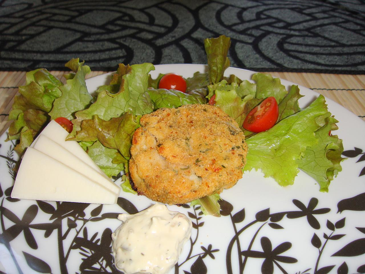 Scallop cakes over salad