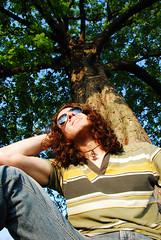 Day 102/365 22 April 2008: Looking Up (Mister J Photography) Tags: sun selfportrait tree sunglasses evening curlyhair regentspark upwards earthday onwards 365days 10secondtimer
