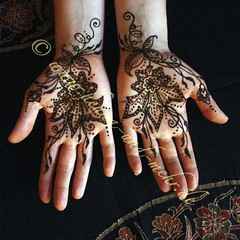 Reflective mehndi or henna on the palms