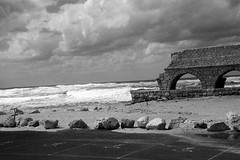 Mediterranean Sea 2 (Poopshe_Bear) Tags: ocean sea summer vacation sky brick beach architecture clouds landscape israel blackwhite sand ruins rocks mediterranean surf waves tide parking bricks aqueduct photograph tides