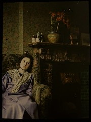 Woman in blue dress sitting near fireplace (George Eastman House) Tags: blue woman fireplace sitting dress georgeeastmanhouse autochrome photo:process=colorplatescreenautochromeprocess color:rgb_avg=231ce geh:accession=197802130001