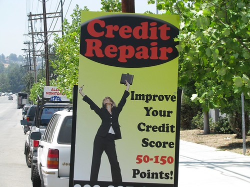 A sign on the street advertising credit repair