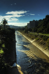 River Caracas Color (mercolino) Tags: trees sky urban rio clouds river palms landscape shadows venezuela caracas hdr guaire urbanlandscape ruices abigfave