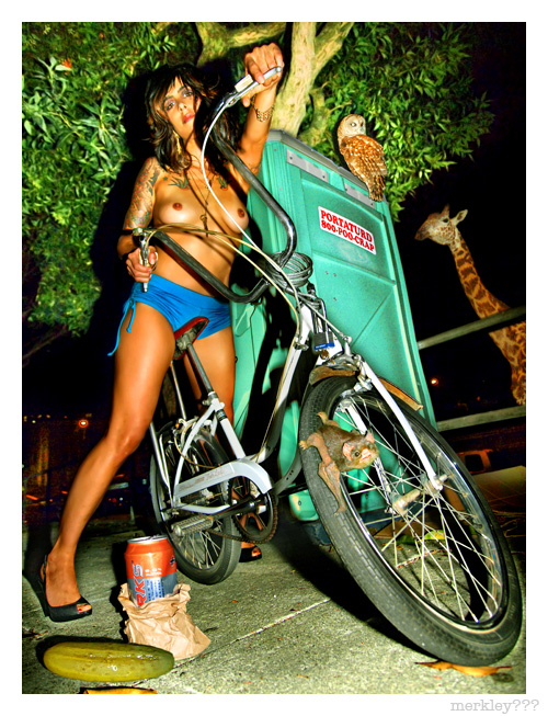 Julianna - Poses Between a Mint Colored Portaturd & Sparks-n-Pickle Snack Under a Tree on The Hayes St. Sidewalk as an Owl & Giraffe Pay 0 Mind to a Small Bat Gripping The Front Wheel of Her Daughter's Schwinn Fair Lady Bicycle