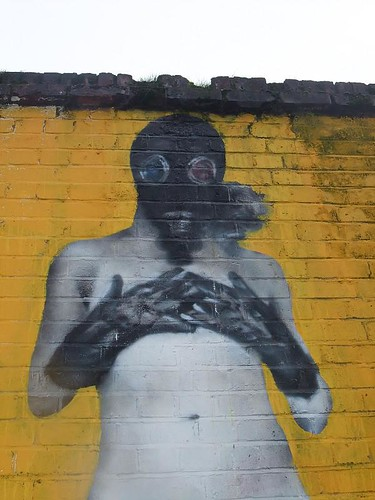 body in gas mask and rubber gloves -- graffiti