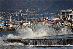 Chaos (Dreamcatcher photos) Tags: ocean africa red sea sky color reflection southafrica bay harbor pier boat town fishing colorful surf harbour painted jetty indian vessel rope quay western cape peninsula trawler bollard kalk kalkbay