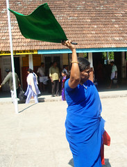 Green flag for train (bokage) Tags: woman india station train dress kerala master trivandrum thiruvanathapuram